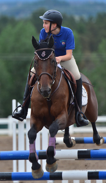 Emily Fraser, 13, of Greenwood Village rides China's Rebal over a jump on Wednesday. The youngster was competing in the low and low trainer competitions.