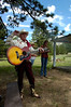 27heritage12.jpg Cowboy singer Ron Ball explains some of the history of the Macgregor Ranch to kids at the Heritage Camp last week. He wears an authentic Roy Rogers' outfit, from hat to boots.