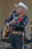 25EP View Ron Ball.jpg Photo by Walt Hester<br /> Cowboy singer and musician Ron Ball croons crowd favorites at the Heritage Festival on Saturday. The festival featured cowboys, mountain men and actors portraying figures from Estes Park's history.