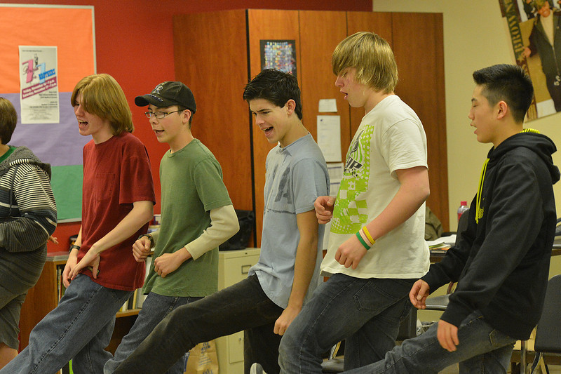 Young men perform one of the best-known Monty Python songs during a prctice on Monday. Monty Python blurred lines and pushed boundries of performance art 40 years ago, and is still finding new fans today.