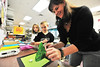 Elementary school art teacher Valerie Bowles uses a packing peanut to make her students' art 3-D on Monday. Bowles sees art as a discipline that brings many other, history, math, sciences, reading, into one.