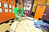 Matthew Birchfield, 12, creates a travel poster in his class on Monday. Art classes can use projects to promote other learning, such as culture and geography.