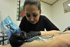 09EPLPht2 Touch Up.jpg The artist adds some color to an existing tattoo. Livingstone does a lot touch-up and cover-up work.