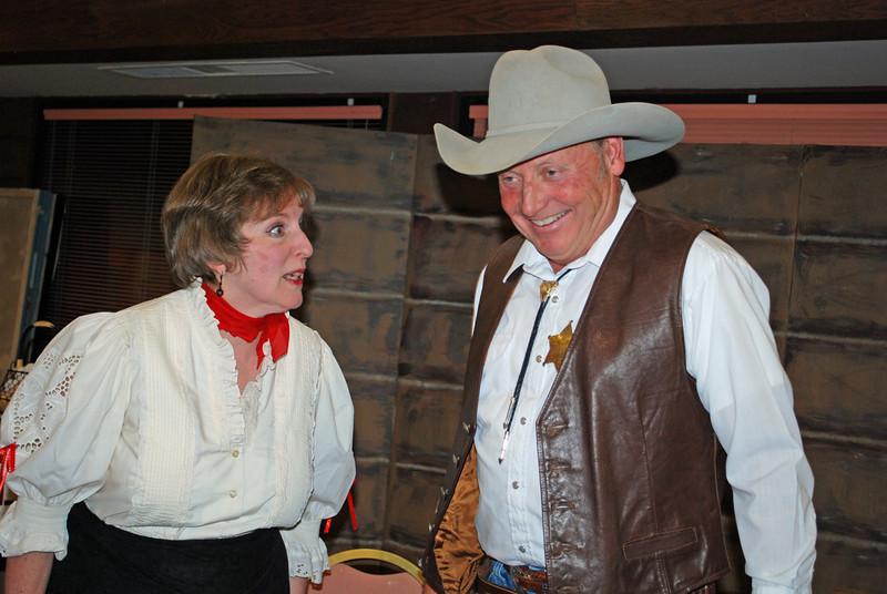 Innkeeper Abigail Miser (Linda Shaffer) & Sheriff Beuford T. Clueless discuss the spitting habits of Estes Parkians.