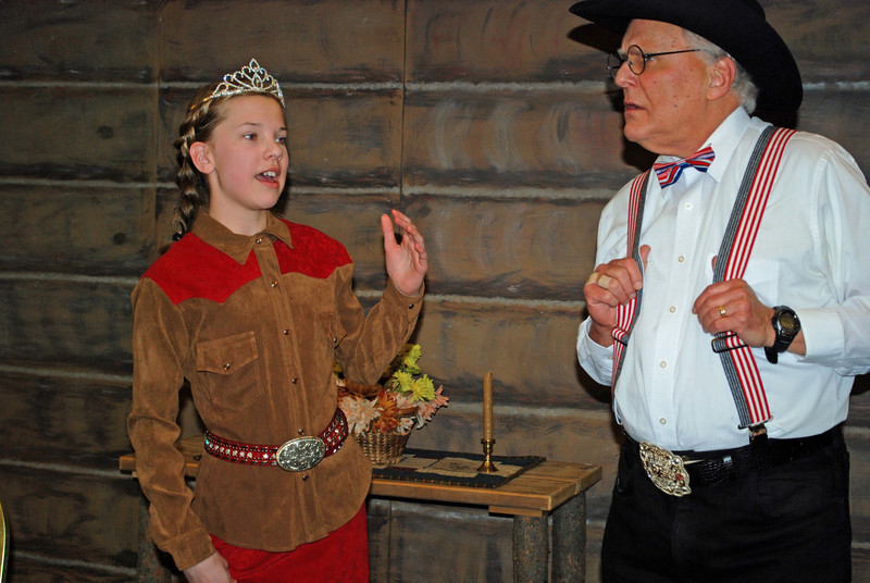 Rodeo queen Katie Royal (Azelan Amundson) tells her story to rodeo executive Rufus Topper (Rich Mitchell).<br />