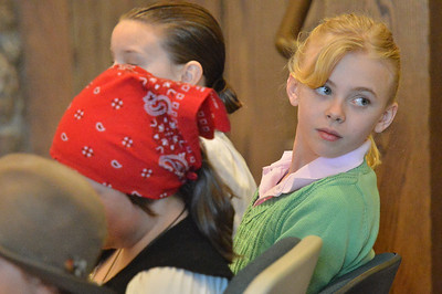 Camdyn Arnold, a sixth grader, looks back to see friends and family at the Estes Park Town Hall on Saturday. Estes Park's Young Chautauquans and their family used the board room to display their historic characters.