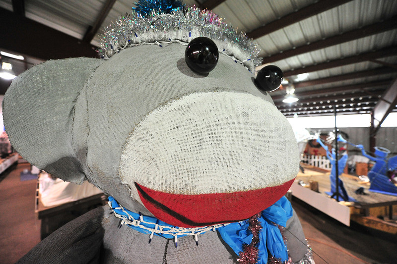 An enormous sock monkey sits atop one of the many floats set to trundle down Elkhorn Avenue next week.