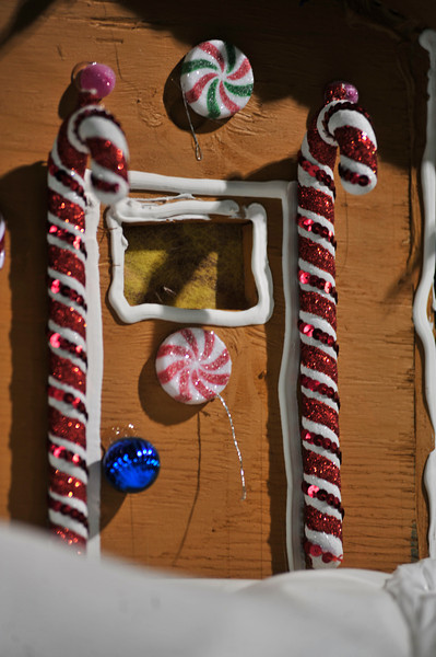 Plastic candies decorate a gingerbread house on one of the Catch the Glow Parade floats on Monday. Holiday details decorate much of the floats in the parade.