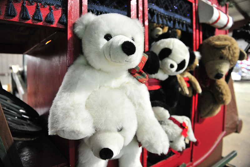 Stuffed animals hang out of a stage coach, awaiting final arrangement for next week's parade. Artist Michael Young and the town works employees often rearrange and recycle elements from old floats to make new floats.
