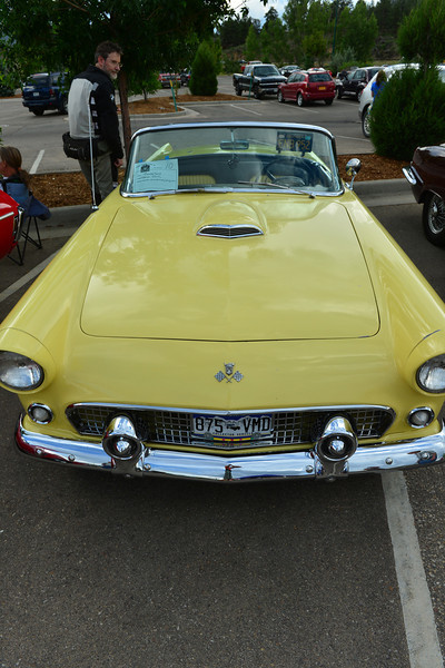 A classic Thunderbird attracts attention at the Cruz In car show on Friday.
