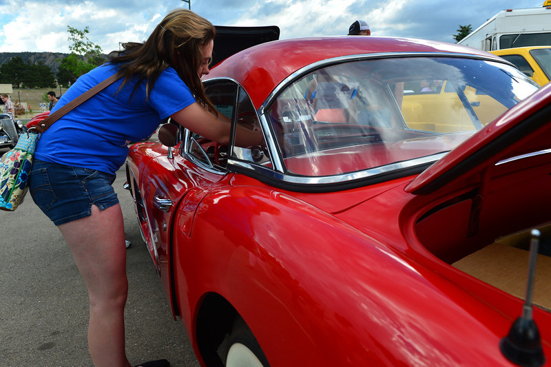 An admirer leans in to photograph the dash of a 1960 Corvette on Friday. The brand celebrated its 60th anniversary this week.
