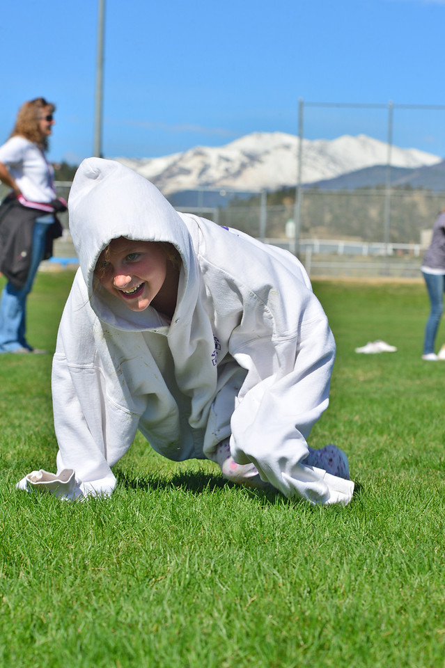 Kristen McCrea quickly crawls in an over-sized sweatshirt during a race at the annual elementary school field day on Wednesday. The event is one of the markers of the end of the school year.