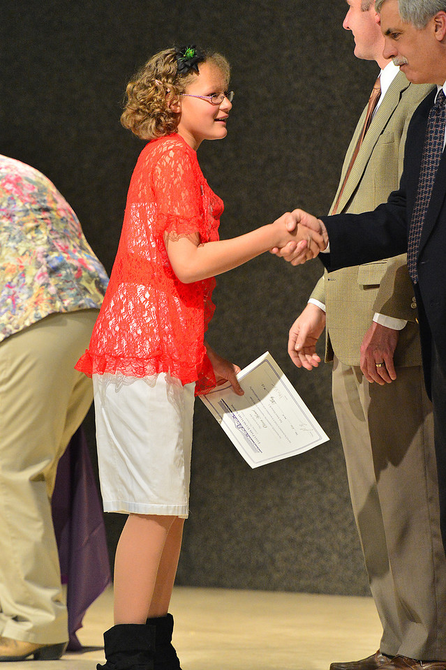 Olivia Hamel receives congratulations and hand shakes during Tuesday's Fifth-Grade Promotion ceremony. The event celebrate the end of the students' elementary school education.