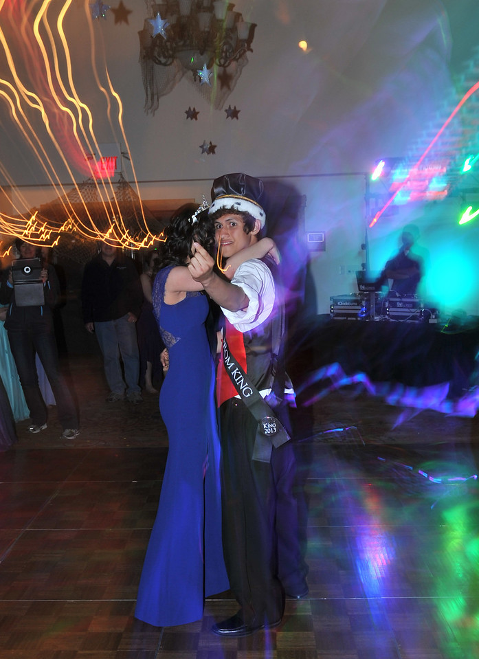 Newly-crowned Prom king, Sean McAlpin, urges friends to join him and his queen, Annette Cinac, on the dance floor on Saturday. In Estes Park, it is almost rare when the king and queen are a couple, so the dance for the new royalty tends to be short.