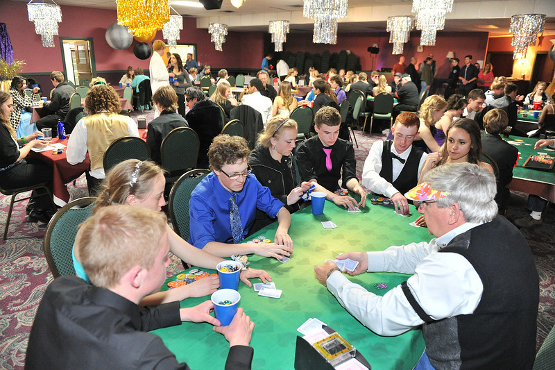 Mostley well-dressed attendees anjoy some faux-gambling at Sunday morning's after prom party, sponsored by the Longs Peak Rotary Club. The club estimated that about 130 out of 150 kids followed up their Prom with a trip to the Village Playhouse for early-morning fun.