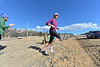 Lisa Marshall of Estes Park turns to cross Devils Gulch Road in the Frost Giant 10k on Sunday. The longer route took runners up Virginia Drive, across Wonderview, through the neighborhood back to MacGregor Avenue, through MacGregor Ranch land, back to MacGregor Avenue and back to the Town Hall for the finish.