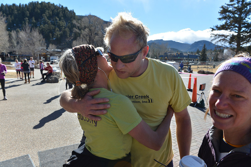 Becky and Ben Greer hug after finishing Sunday's Frost Giant 10k. The annual run attracts all kinds of runners, from serious, fast ultra-listance athletes to families out for a fun run in the middle of winter.