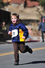Josiah Moore, 5, of Wellington makes a final sprint for the finish of the Frost Giant 5k on Sunday. A friendly little race, participents range in age from 5 to well into the 70s.
