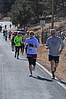 A long line of runners trudge up MacGregor Avenue during the 10k on Sunday. The Frost Giant was originally organized to give local runners something to do in the dead of winter.