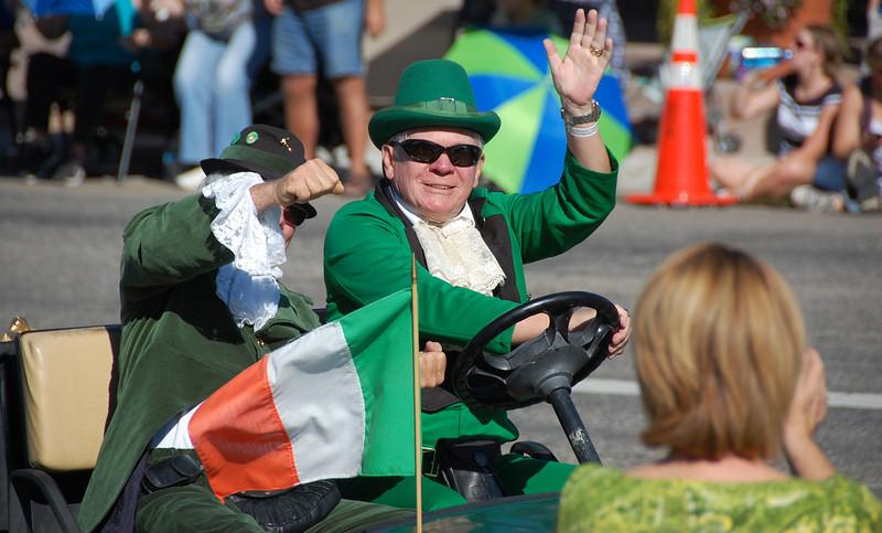 The Longs Peak Scottish./Irish Highland Festival Parade leprechaun offers an Irish greeting to parade watchers.