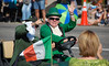 The Longs Peak Scottish./Irish Highland Festival Parade leprechaun offers an Irish greeting to parade watchers.