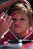 22EPLPht Flowery Face.jpg A youngster enjoys decoration at the Whiskey Warmup. Face painting was a popular activity among the meny offered at the weekend event.
