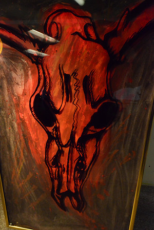 18EPStand Ghost work.jpg Glass, paint and canvas create a ghostly effect in a painting by Estes Park High School student Austin Holmes. Holmes put color on a background then painted the skull outline on glass so when a light was shined on the work, the outline cast shadows.