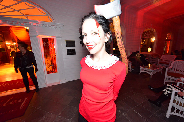 29EPNews Axed about her headache.jpg One of the many revelers at the Stanley Hotel's Shining Masquerade Ball enjoys some attention on Saturday. The event attracts costume and Halloween fans from as far away as the West Coast and Texas.