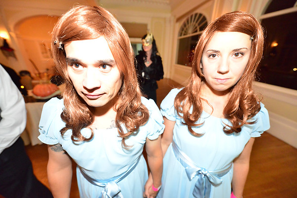 05EPLPht The Twins.jpg Eric and Nora Climaco of Denver dress as the infamous twins of the Shining and Stanley Hotel ghost stories at the storied hotel on Friday night. The Shining twins are always a popular couples costume at the Stanley Hotel's masquerade ball.