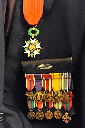 Walker's uniform is full of medals for his service, including a Purple Heart and the Knight of the Legion of Honor. The Legion of Honor was established in 1802 by Napoleon Bonaparte.