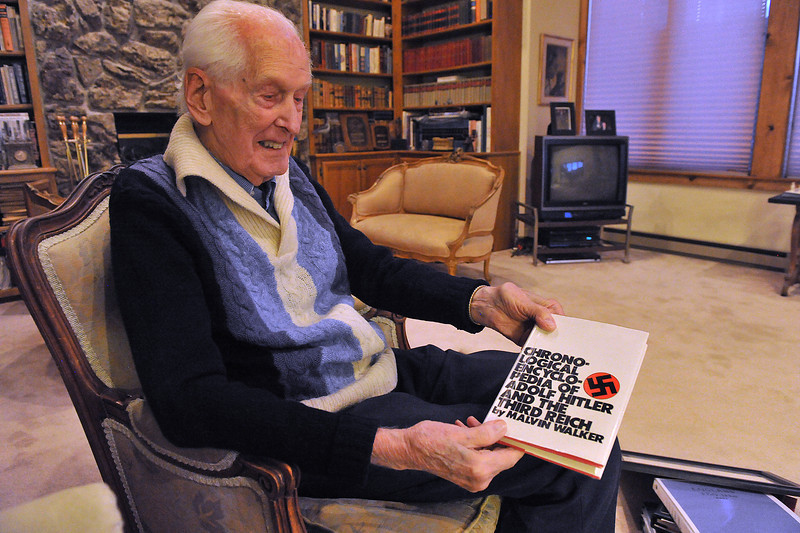Mal Walker shows a book he authored aboyt the Nazis and their infamous leader. Soldier, musician, teacher and author, Walker has accomplished much in his life.