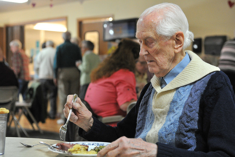 Mal Walker prepares to dig in to lunch atthe Estes Valley Senior Center on Monday. Waker shows up at the center nearly every day.