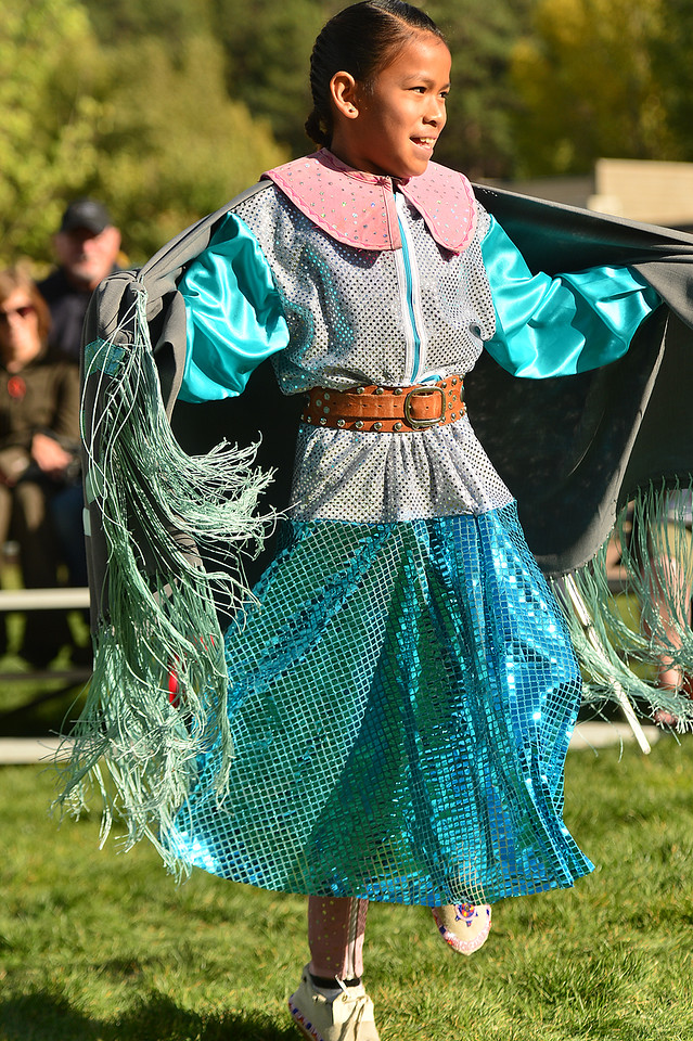A modern shawl dancer shows off her moves on Sunday. The shawl dance was a reaction to the men's fancy dance, proving the girls could keep up.