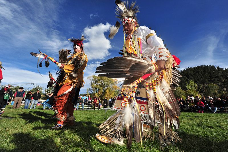 More traditionally dressed dancers slowly march past visitors at Elk Fest on Sunday. Native American dancers are divided into several catagories based on both dress and dance style.