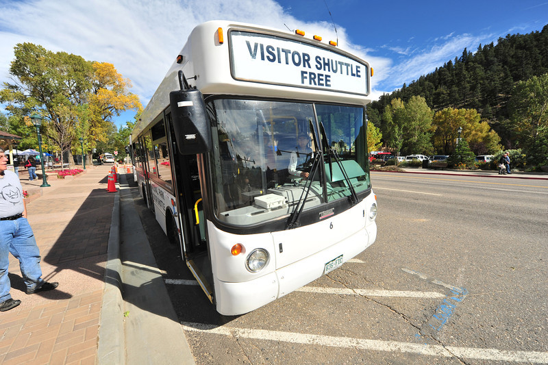 A shuttle bus waits to collect visitors at the Elk Fest and take them to see the herds around town.