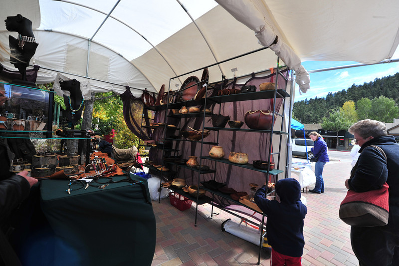 An artist displays leather and bone art at the Elk Fest on Sunday. Several artists made the trip up to Estes Park for the festival.