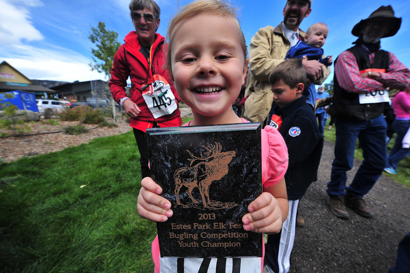 Lena McIntyre, 5, of Estes Park proudly holds her award for winning the youth bugling competition on Sunday. The young girls is a two-time winner of the competition.