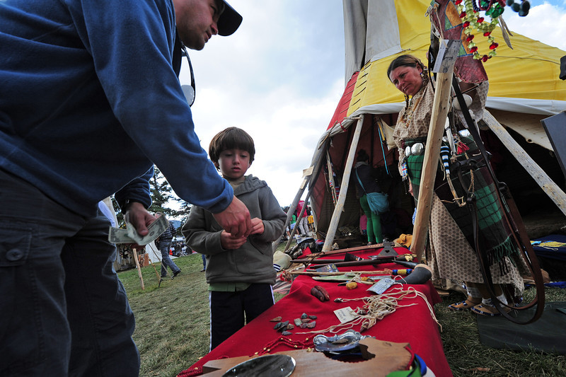 Visitors purchase wares from the mountain men at the Elk Fest on Sunday. The mountain men gathered to sell the things they would have needed for trade a century ago.