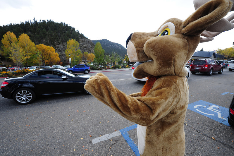 The Elk Fest's mascot waves to traffic and tries to lure visitors to the annual festival on Sunday. The weather stayed pleasant for most of the weekend, with short periods of rain toward the end of the day on Sunday.