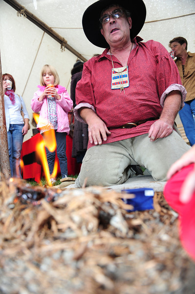 A mountain Man demonstrates fire building during Sunday's Elk Fest. The mountain men show visitors how life was in the Mountain West a century ago.