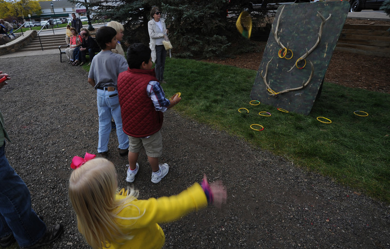 Children toss rings at antlers at the Elk Fest on Sunday. The festival had plenty to keep visitors occupied between bugling contests, games for kids, music, dancing, demos and food.