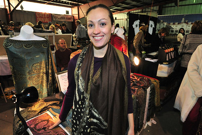 Veronika Londono of Denver displays her shawls at the WInter Festival. Londono is a returning vender and plans to come back again next year.