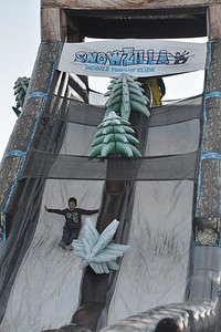 A child plummets down an inflatable slide at the annual Winter Festival on Saturday. The slide was a new attraction brought in this year.