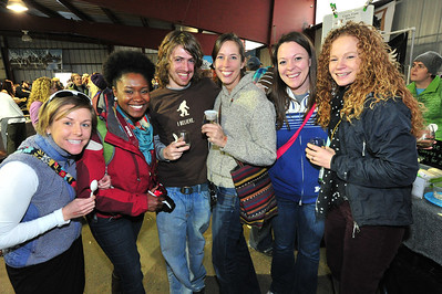 """Smiling revelers enjoy beer tasting at the festival. Visitors were treated to beer tasting, wine, cheese, chili and """"Mac and Cheese."""""""