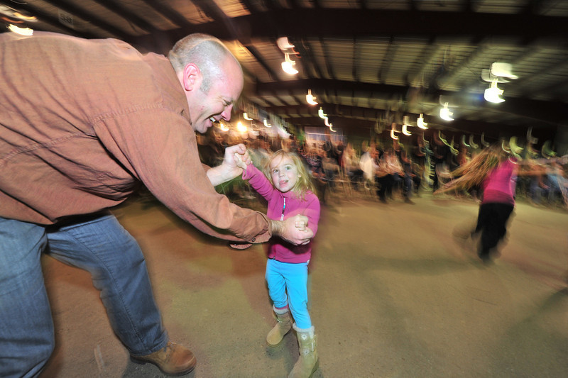 Elise Brandon, 4, dances with her father, Jeff, both from Centennial, at Friday night's Cailidh Barn Dance on Friday. The dance was the opening event of the fourth annual Estes Park Winter Festival.