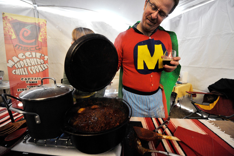 20EP View Maggie's Superheros.jpg Photo by Walt Hester<br /> Local chili cook Barney Treadway, one of Maggie's Superhero Chili Cooks, shows off his creation before the judging on Saturday. Cooks were given specific criterea Saturday's contest, no fillers, like beans, allowed.