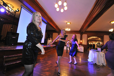 Rotarians dance across the floor at Casino Night on Saturday. More than games, music played to add a different sort of fun.
