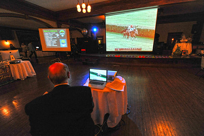 A computerized horse race dance across a big screen on Saturday night. Many games of chance were offered for those who attended the Casino Night.