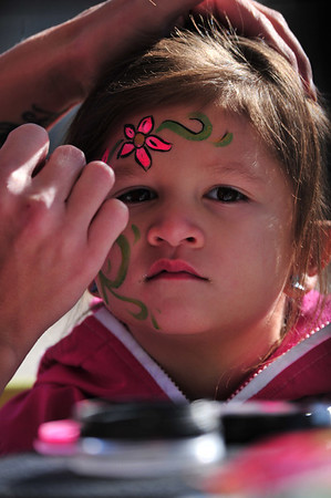 A youngster enjoys decoration at the Whiskey Warmup. Face painting was a popular activity among the meny offered at the weekend event.