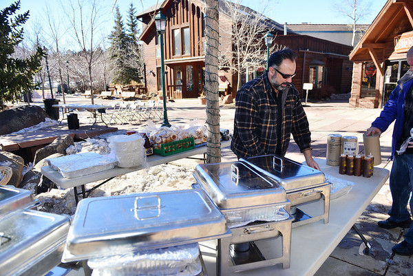 Smokin' Dave sets up his sweet and spicy station in Riverside Plaza on Saturday. The Whiskey Warmup offered spirited food as well as the distilled spirits.